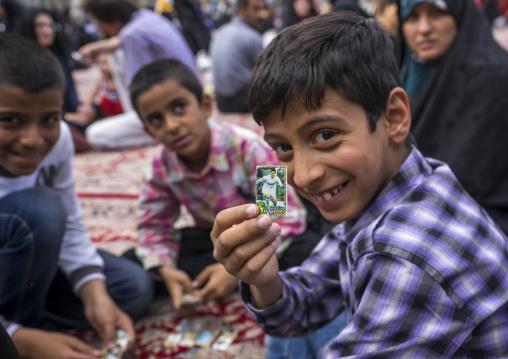 Pilgrim child showing a ronaldo sticker at the shrine of fatima al-masumeh, Qom province, Qom, Iran