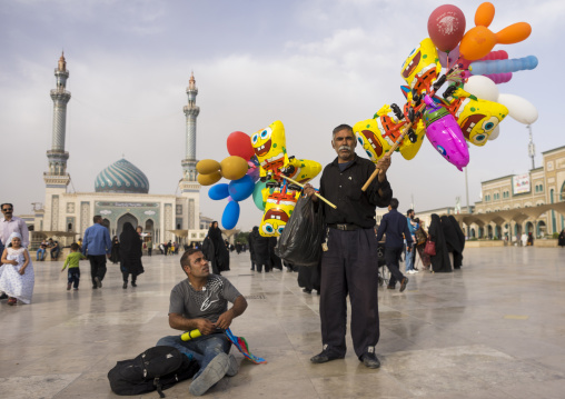 Men selling balloons in front of imam hassan mosque, Qom province, Qom, Iran