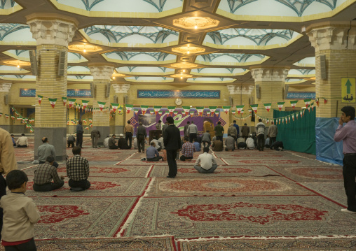 Pilgrims praying in front of the ayatollah khomeini mausoleum, Shemiranat county, Behesht-e zahra, Iran