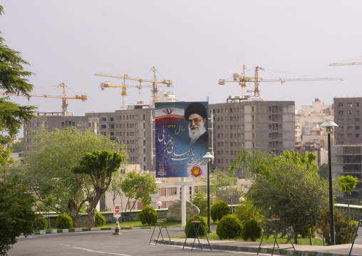 Billboards of khameini in front of cranes, Shemiranat county, Tehran, Iran