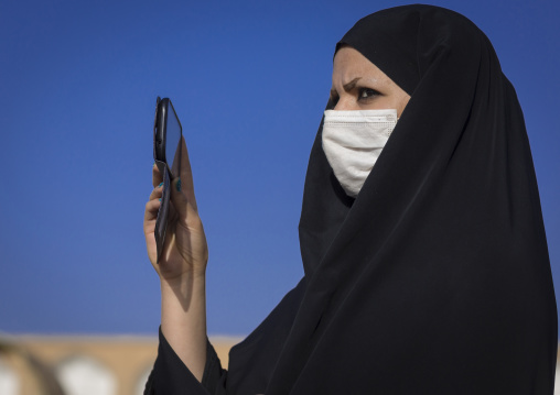 Veiled woman taking pictures with her mobile phone, Isfahan province, Isfahan, Iran