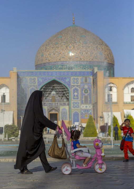 Veiled mother pushing a baby cart in naghsh-i jahan square, Isfahan province, Isfahan, Iran