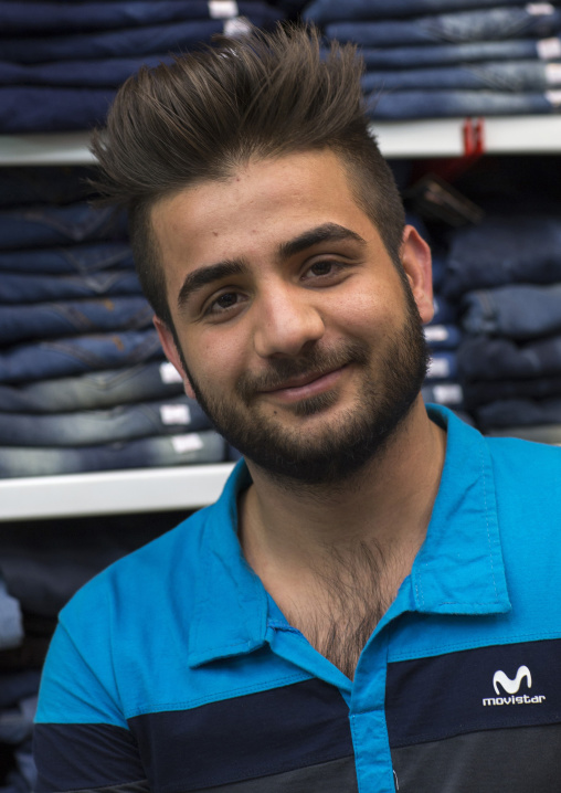 Young man with western haircut in the bazaar, Isfahan province, Isfahan, Iran