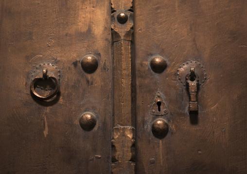 Old door with two doorknockers for men and women, Isfahan province, Kashan, Iran