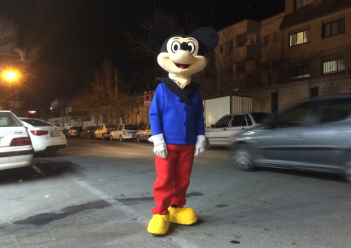 Man In A Mickey Mouse Disguise In The Street To Promote A Shop, Central District, Theran, Iran
