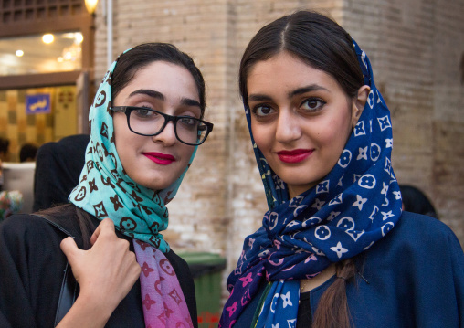 Iranian young women with louis vuitton scarves, Central district, Tehran, Iran