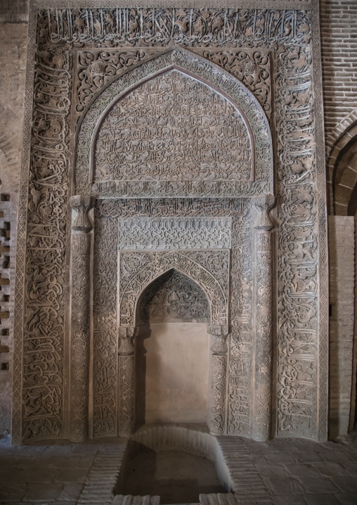 Ornate arabic calligraphy on the Oljeitu mihrab at the Jameh masjid or Friday mosque, Isfahan Province, Isfahan, Iran