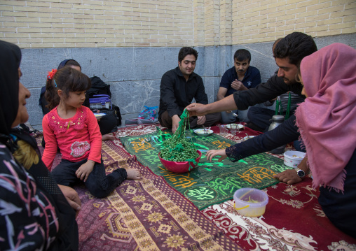 Iranian family who gives for free some prayer beads to mourners to see their wish happen, Isfahan Province, Isfahan, Iran