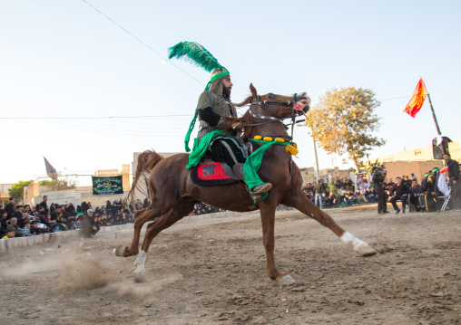 Man riding a horse during a traditional religious theatre called tazieh about Imam Hussein death in Kerbala, Isfahan Province, Isfahan, Iran