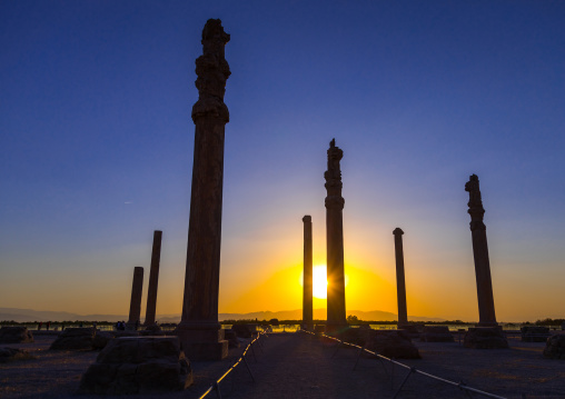 General overview of the remains of  ruins of the apadana in Persepolis at sunset, Fars Province, Marvdasht, Iran