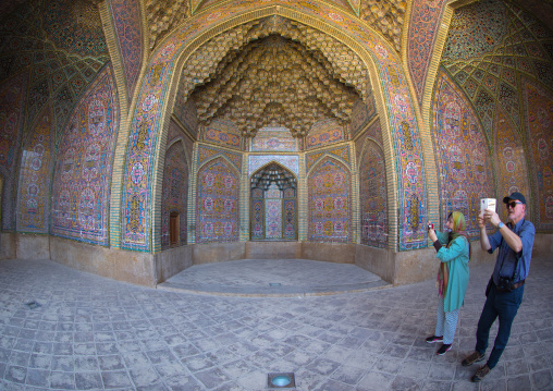 Tourists taking pictures in nasir ol molk mosque, Fars province, Shiraz, Iran