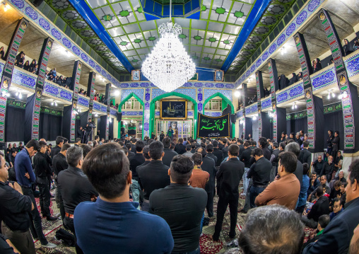 Iranian shiite muslim mourners chanting  during Muharram inside a hosseinieh, Yazd Province, Yazd, Iran