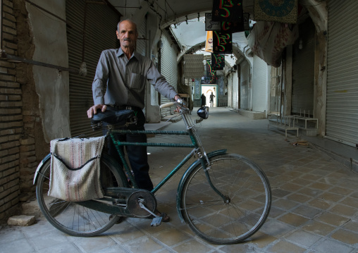 Old man with his bicycle in the empty bazaar, Yazd Province, Yazd, Iran