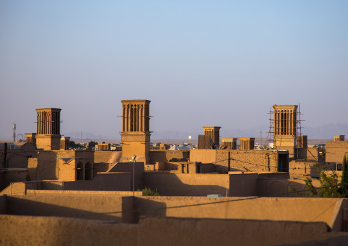 View of the city with traditional wind catchers and mosques at dusk, Yazd Province, Yazd, Iran