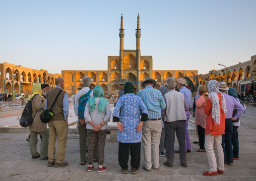 Tourists in front of the three-storey takieh part of the amir chakhmaq complex, Yazd province, Yazd, Iran