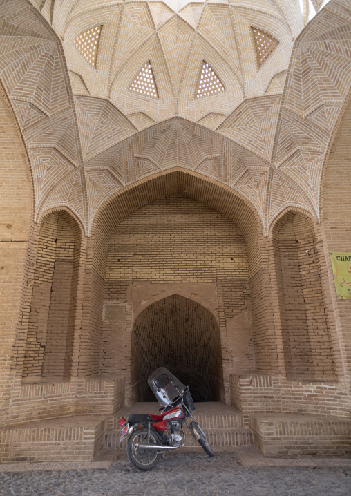 Motorbike in front of the entrance of a water reservoir, Yazd Province, Meybod, Iran