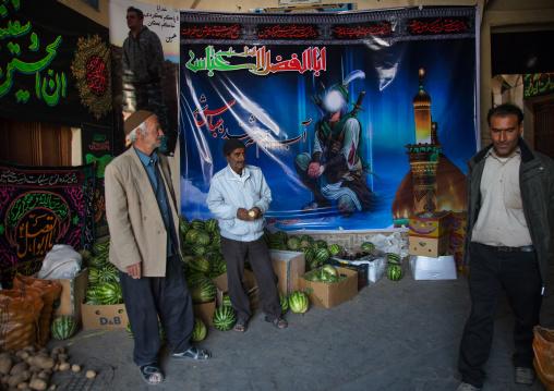 Iranian shiite men in front of a Muharram decoration in the bazaar, Isfahan Province, Nain, Iran