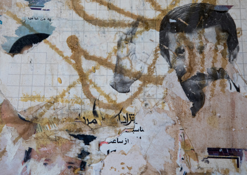 Old teared poster of Mahmoud Ahmadinejad, Isfahan Province, Nain, Iran