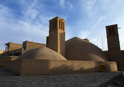 Wind towers used as a natural cooling system for water reservoir in iranian traditional architecture, Isfahan province, Ardestan, Iran