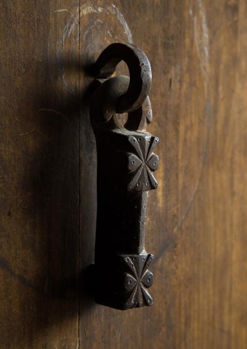 Ancient male doorknocker on a wooden door, Isfahan province, Ardestan, Iran