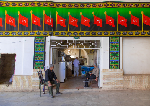 Men in a bakery decorated for Muharram, Isfahan Province, Kashan, Iran