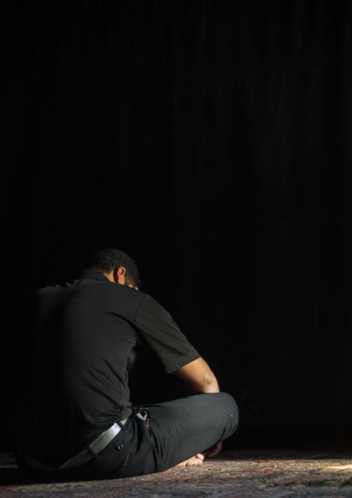 Iranian shiite muslim man praying in a hosseinieh, Isfahan Province, Kashan, Iran