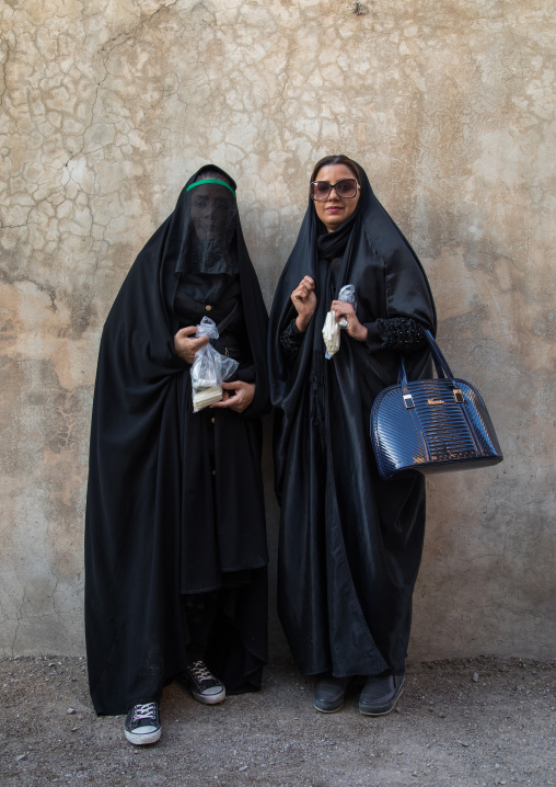 Two iranian shiite women mourning imam hussein on the day of tasua, Lorestan province, Khorramabad, Iran