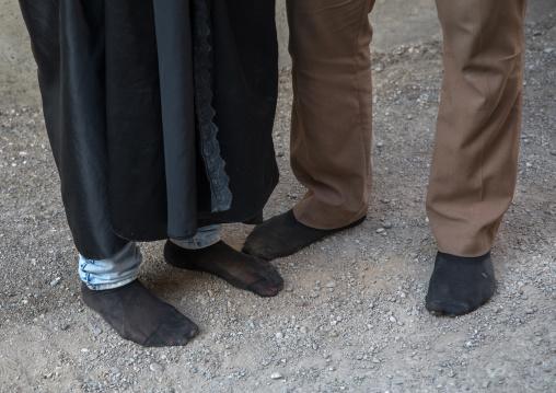An iranian shiite couple walks in stocking feet during the chehel manbar ceremony a day before ashura, Lorestan province, Khorramabad, Iran