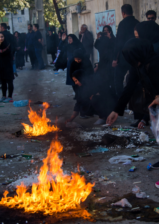 Iranian shiite people light candles and put sugar cubes during chehel manbar ceremony on tasua to commemorate the martyrdom anniversary of hussein, Lorestan province, Khorramabad, Iran