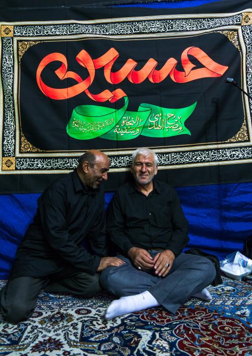 Iranian shiite muslim men having a nazri charity diner during muharram before ashura celebrations, Central county, Theran, Iran