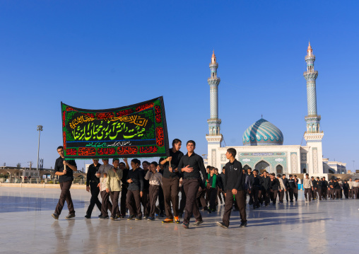 Shiite procession during Muharram passing in front of Imam Hassan mosque, Central County, Qom, Iran