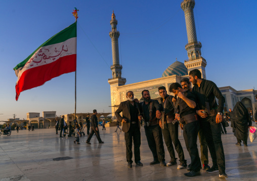 Alam carriers posing in front of Imam Hassan mosque during Muharram, Central County, Qom, Iran