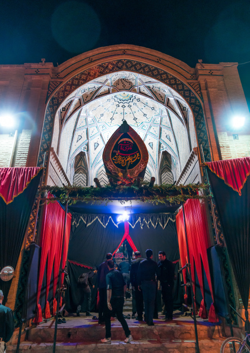Entrance of an Hosseinieh decorated for Muharram where shiite men come to worship Imam Hussein, Isfahan Province, Kashan, Iran