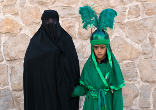 Shhite iranian mother and her son in costume to celebrate Muharram, Lorestan Province, Khorramabad, Iran