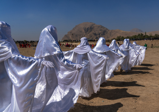 Women in white chadors during a traditional religious theatre called tazieh about imam hussein death in kerbala, Lorestan province, Khorramabad, Iran