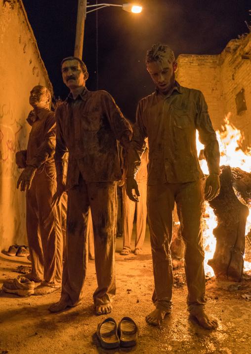 Iranian shiite muslim men gather around a bonfire after rubbing mud on their bodies during the Kharrah Mali ritual to mark the Ashura ceremony, Lorestan Province, Khorramabad, Iran