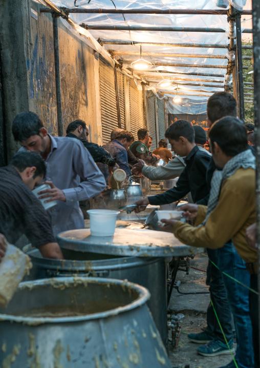 Iranian shiite muslim men prepare the breakfast early in the morning of Ashura day, Lorestan Province, Khorramabad, Iran