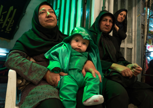 Iranian shiite muslim mother and her son dressed for muharram celebration, Central county, Theran, Iran