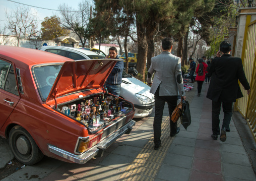 Man selling perfumes bottles in the back of his car in the street, Central district, Tehran, Iran