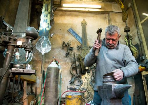 master safar fooladgar creating an alam in his workshop, Central district, Tehran, Iran
