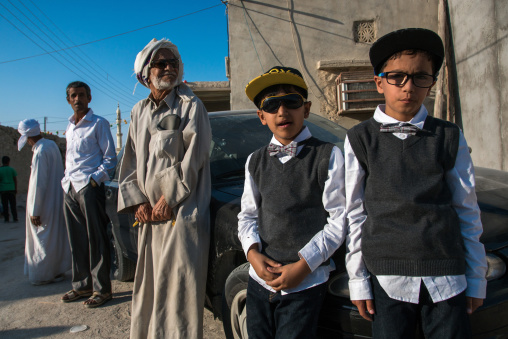 Boys dressed in western way during a traditional iranian wedding, Qeshm island, Salakh, Iran