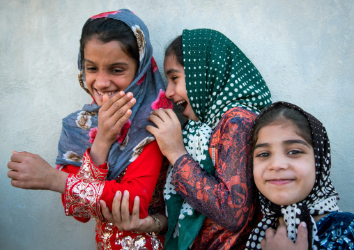 Little girls laughing in the street, Qeshm island, Salakh, Iran