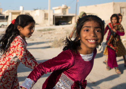 Little girls having fun in the street, Qeshm island, Salakh, Iran