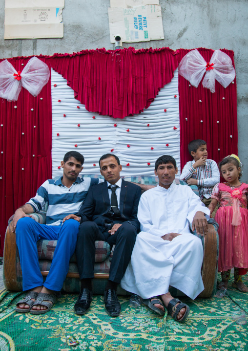 groom posing with his relatives during a wedding ceremony, Qeshm Island, Salakh, Iran