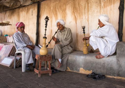 old bandari sailors smoking pipes, Hormozgan, Bandar-e Kong, Iran