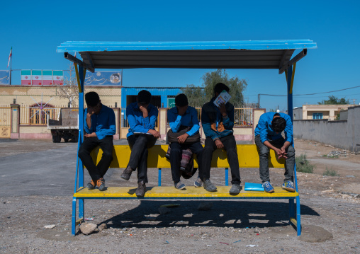 schoolboys waiting for the bus, Hormozgan, Bandar-e Kong, Iran