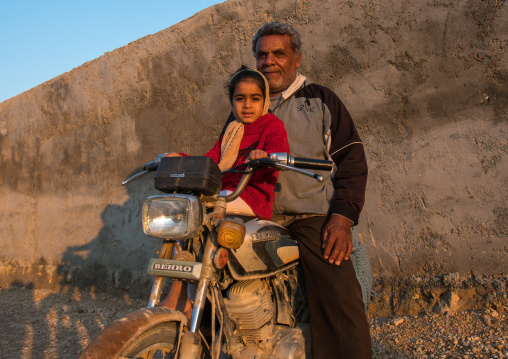 father and daughter on motorbike, Hormozgan, Kushkenar, Iran