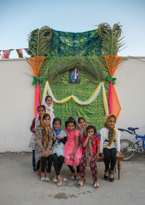 girls in front of a set for a wedding in the street, Hormozgan, Kushkenar, Iran