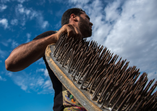 iranian artist carrying a nail bed, Hormozgan, Minab, Iran