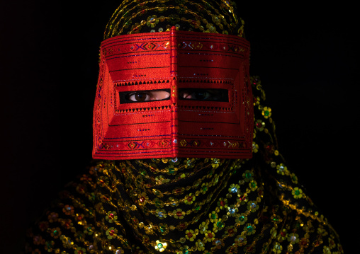 a bandari woman wearing a traditional mask called the burqa, Hormozgan, Minab, Iran